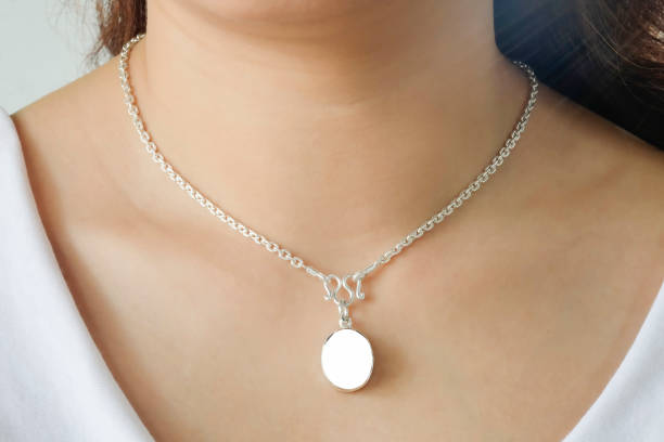woman wearing a mockup montage necklace with empty for add your advertising. - ожерелье стоковые фото и изображения