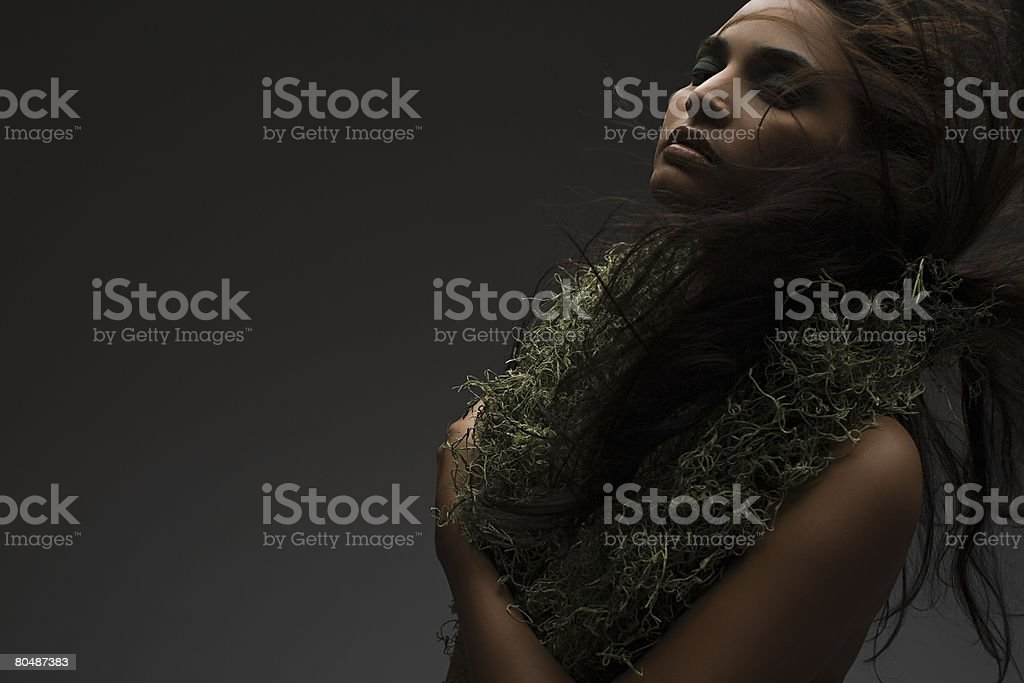 A woman wearing a moss necklace royalty-free stock photo