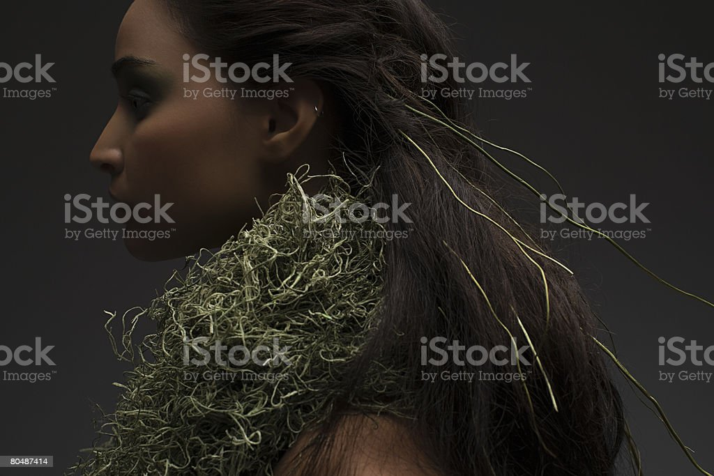 A woman wearing a moss necklace 免版稅 stock photo