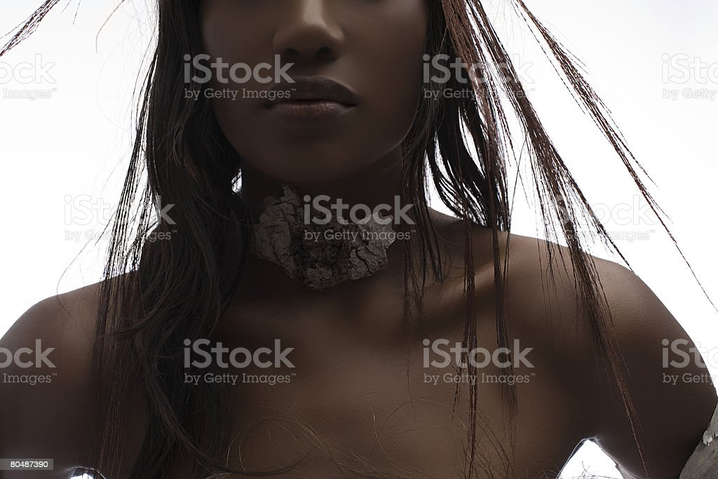 A woman wearing a necklace royalty-free 스톡 사진