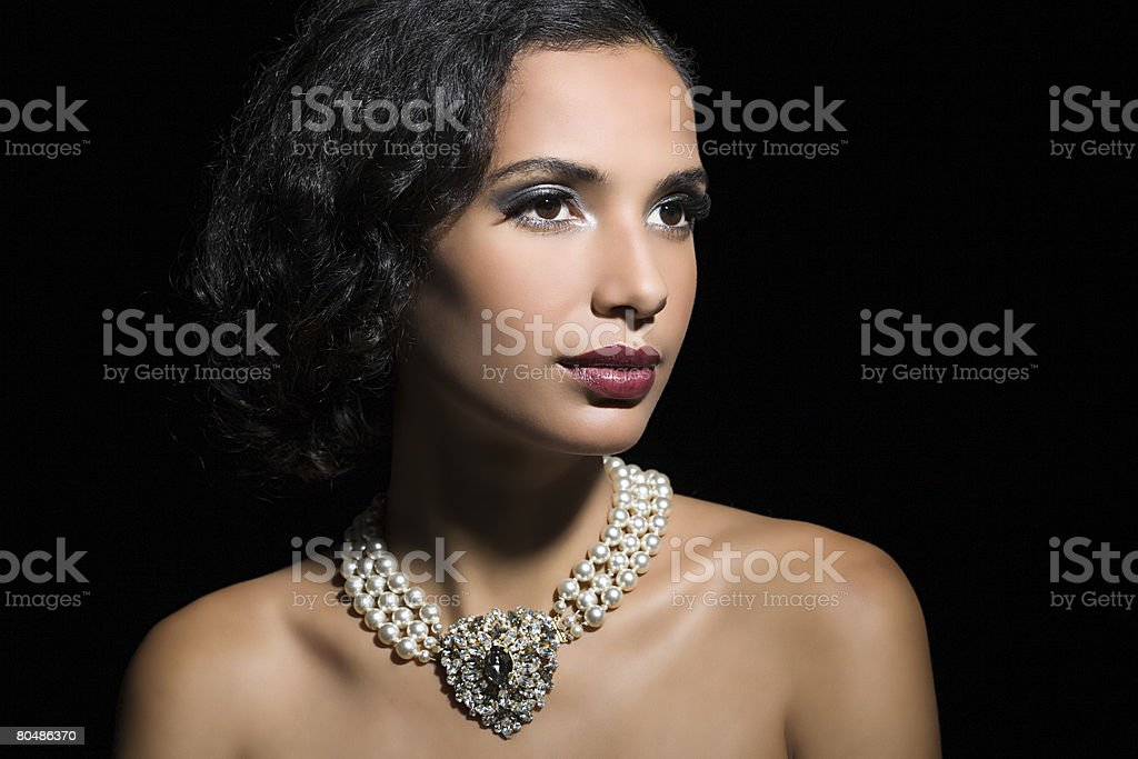 Woman wearing a pearl necklace 免版稅 stock photo