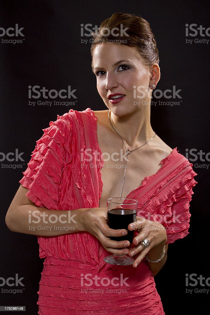 Woman Wearing a Pink Dress Drinking Wine royalty-free stock photo
