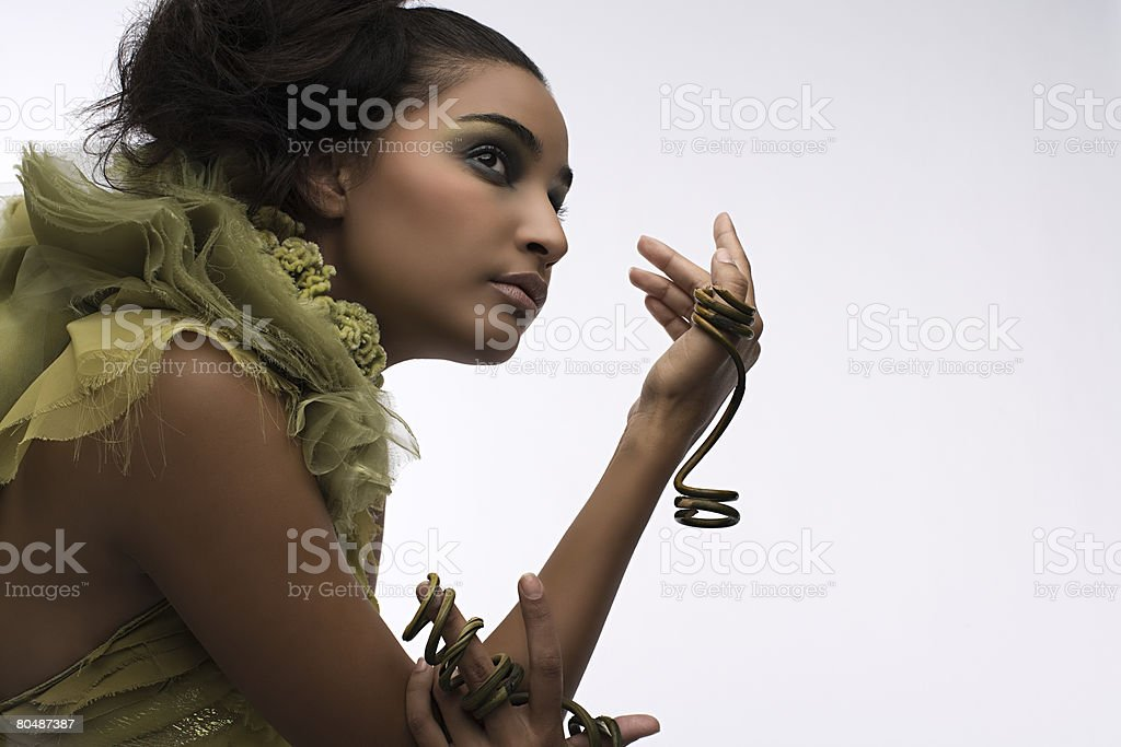 A woman wearing a plant ring royalty-free stock photo