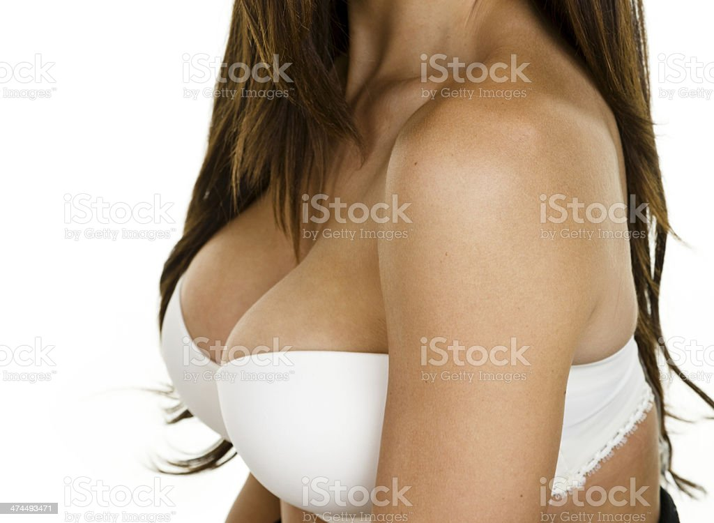 Woman wearing a pushup bra stock photo