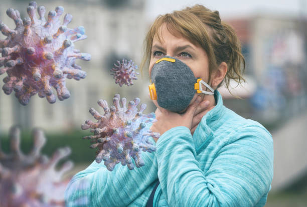 Woman wearing a real anti-pollution and anti-viruses face mask Woman wearing a real anti-pollution and anti-viruses face mask outside. SARS COVID-19 pandemic concept antipollution stock pictures, royalty-free photos & images