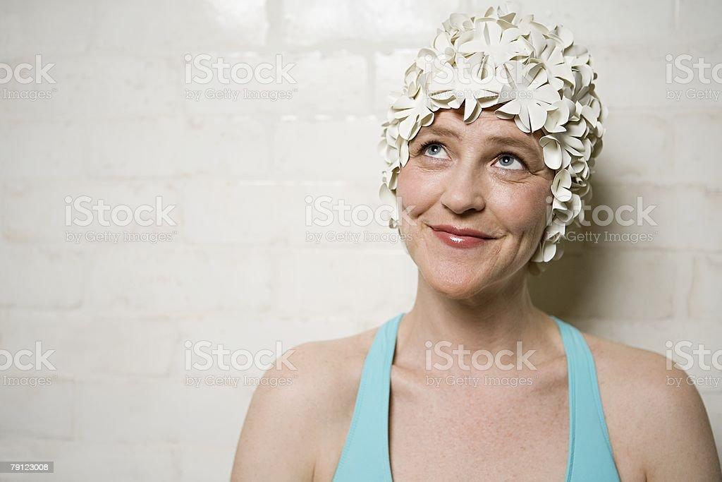 Woman wearing a retro swimming cap stok fotoğrafı