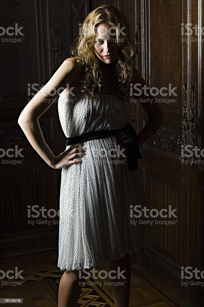 Woman wearing a spotted dress royalty-free 스톡 사진