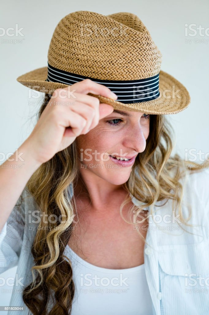 Woman Wearing A Straw Fedora Peering Away Stock Photo - Download Image Now