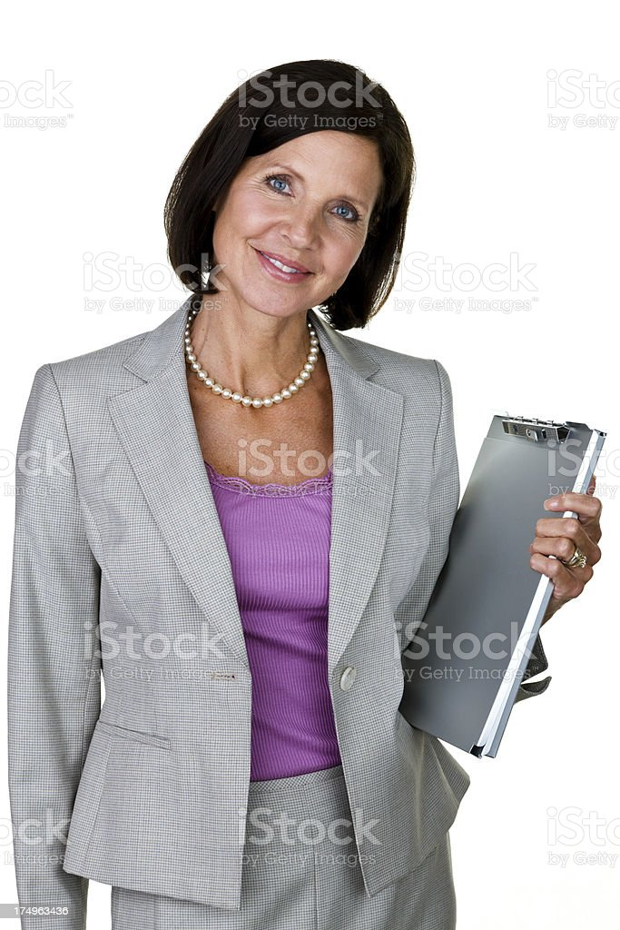 Woman wearing a suit and holding  clipboard royalty-free stock photo