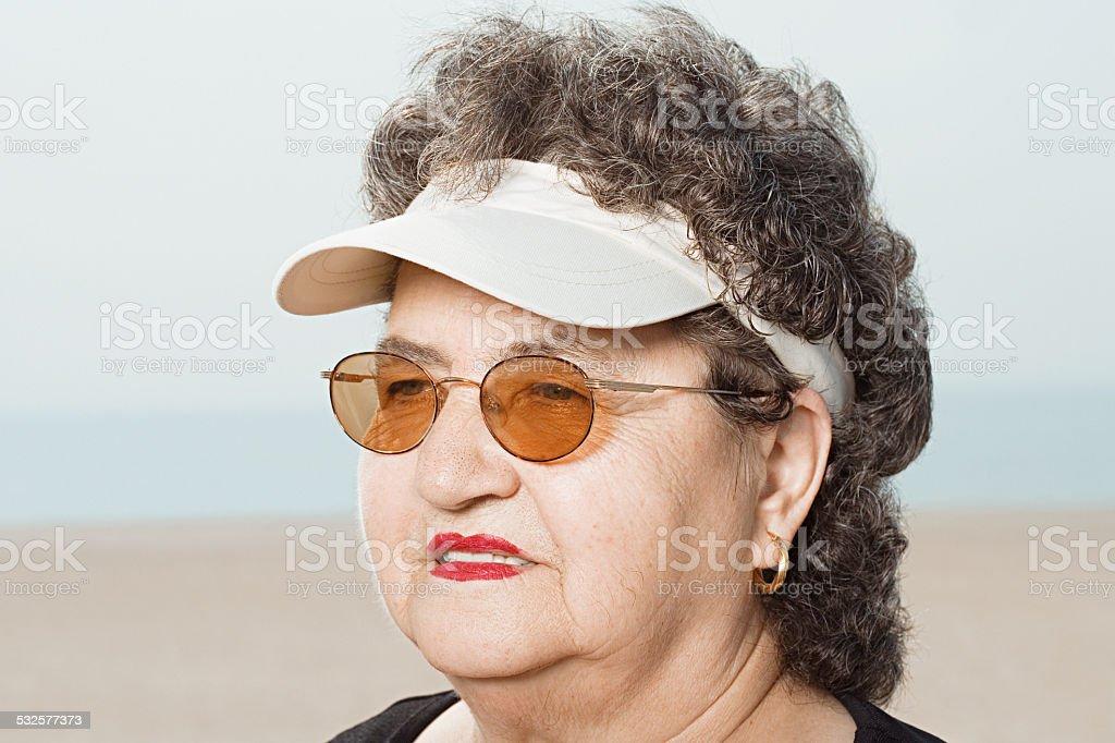 Woman wearing a sun visor stock photo