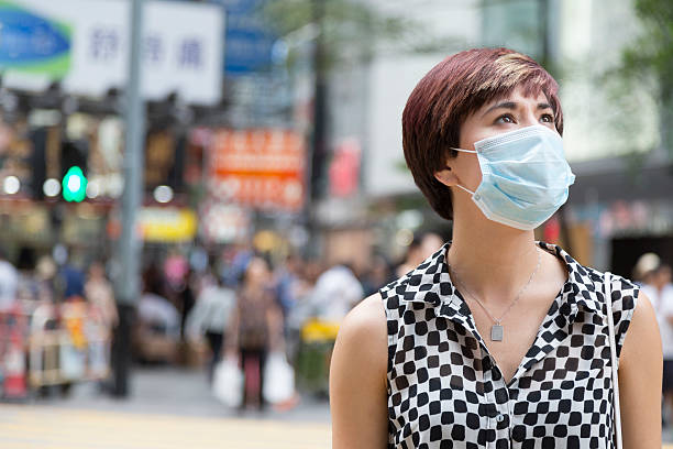 Woman Wearing a Surgical Mask in Hong Kong stock photo