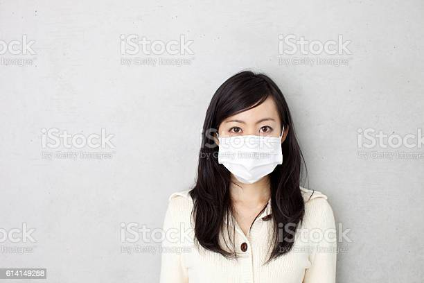 Woman wearing a surgical mask picture id614149288?b=1&k=6&m=614149288&s=612x612&h=ip9s4adoxy0fie0niu5apgsmlqilnt8d7atqsk1sc78=