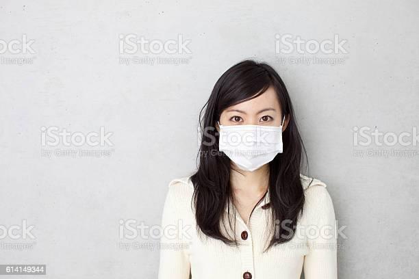 Woman wearing a surgical mask picture id614149344?b=1&k=6&m=614149344&s=612x612&h=qbsysk2w038 skwfzhh60ikcwevi7ptzb9m14l7drcy=