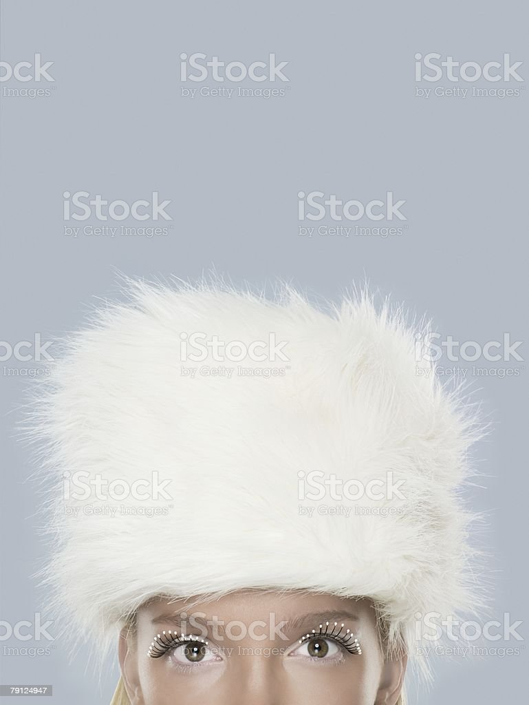Woman wearing a white fur hat royalty-free 스톡 사진
