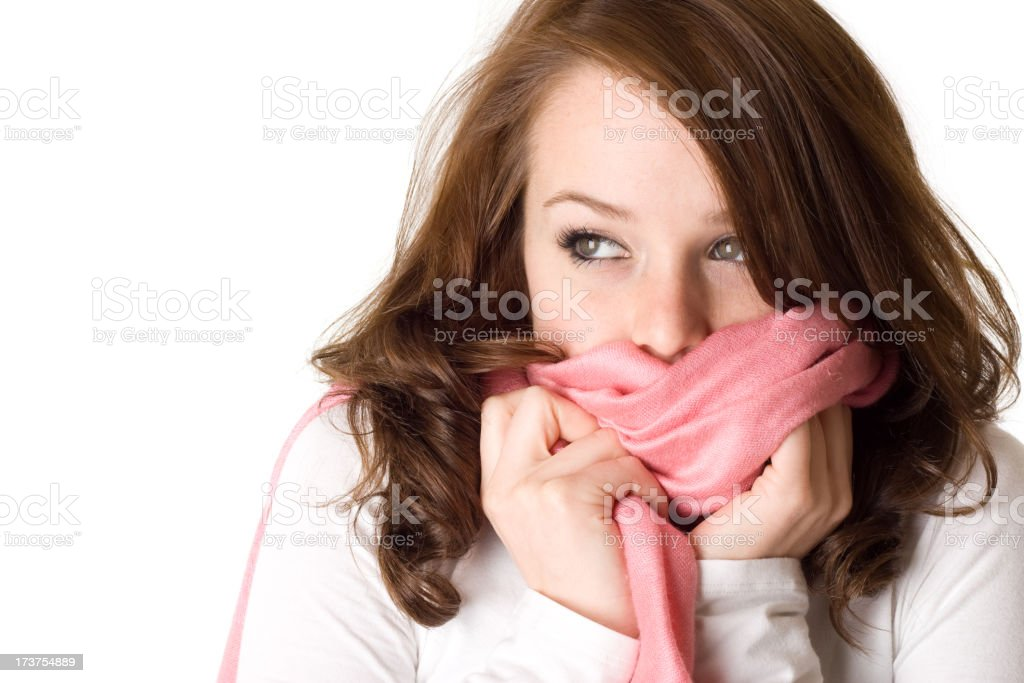 Woman wearing a white shirt covering her mouth with a scarf royalty-free stock photo