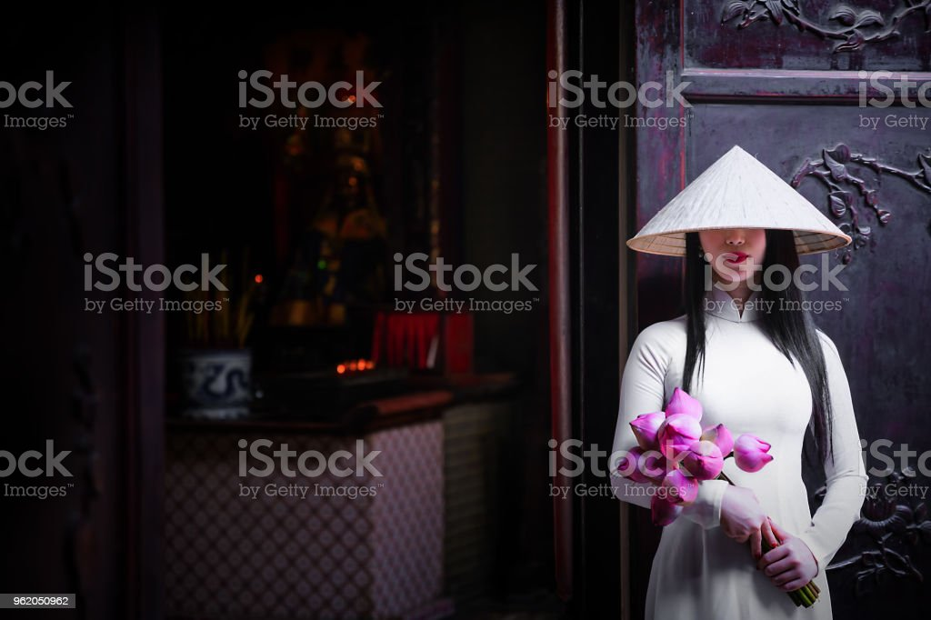 Woman wearing Ao Dai culture traditional at old temple. stock photo