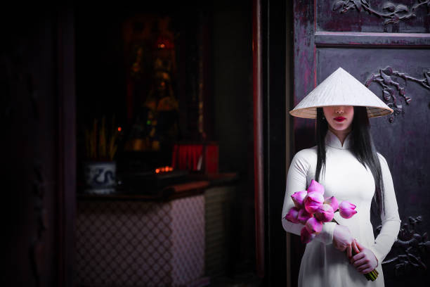 woman wearing ao dai culture traditional at old temple. - ao dai stock photos and pictures