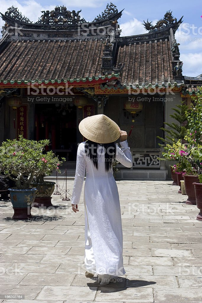 Woman wearing Ao-Dai outside in Vietnam stock photo