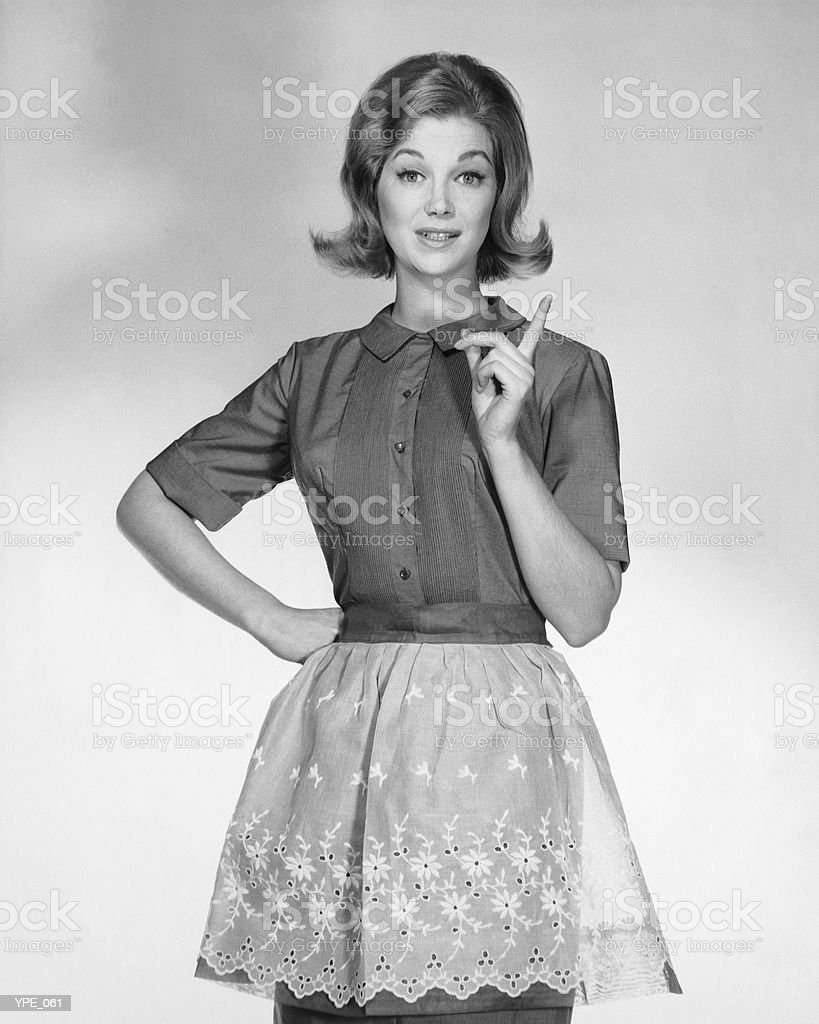 Woman wearing apron, gesturing 免版稅 stock photo