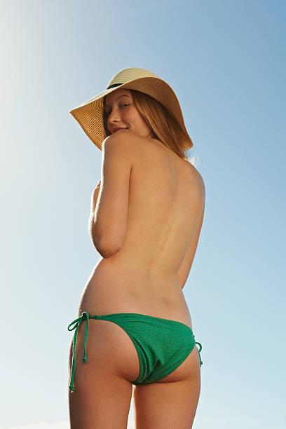 Woman wearing bikini bottoms and hat stock photo