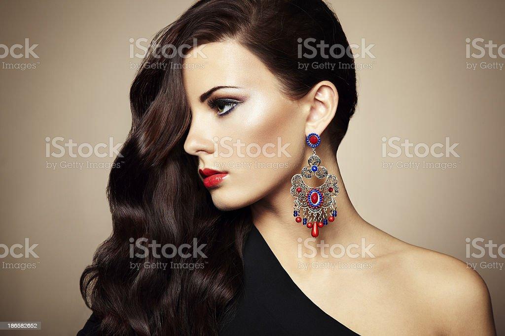 Woman wearing black dress and stylish earrings stock photo