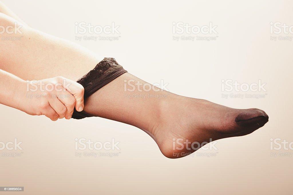 Woman wearing black stockings stock photo