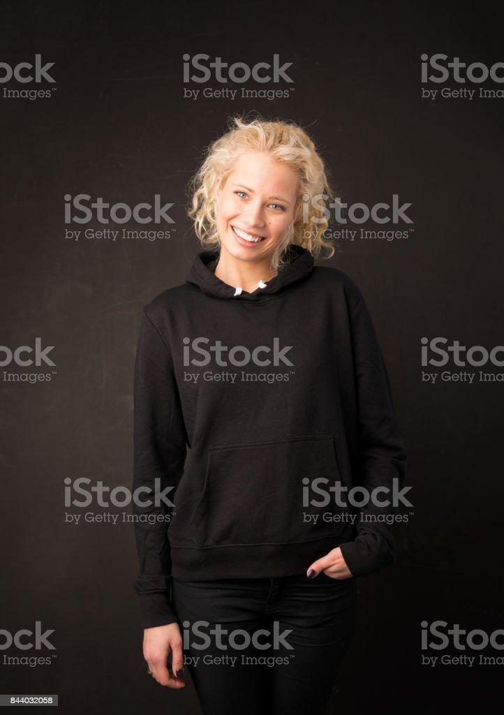 Woman wearing black sweater stock photo