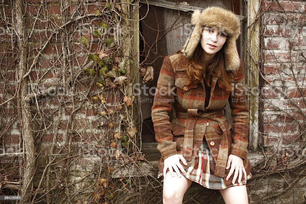 woman wearing brown plaid outfit stock photo