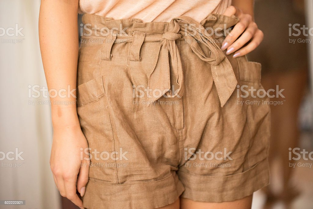 woman wearing brown short close up stock photo