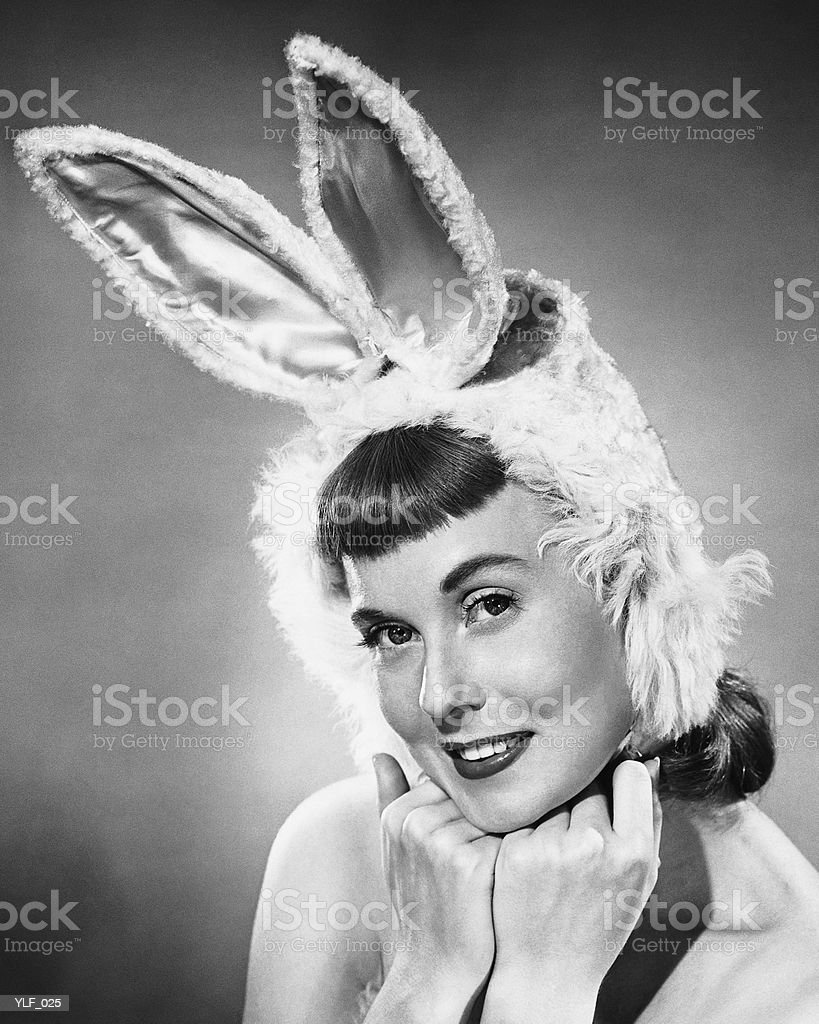 Woman wearing bunny hat royalty-free stock photo