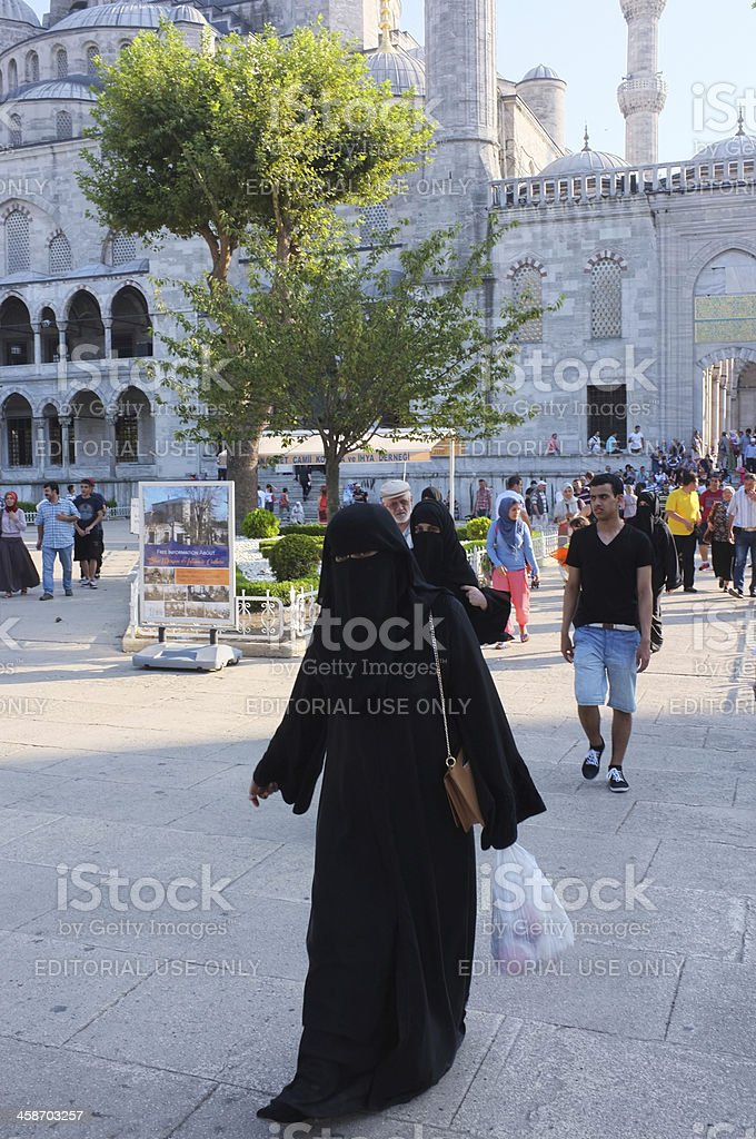 Woman wearing burka outside Blue Mosque Istanbul royalty-free stock photo