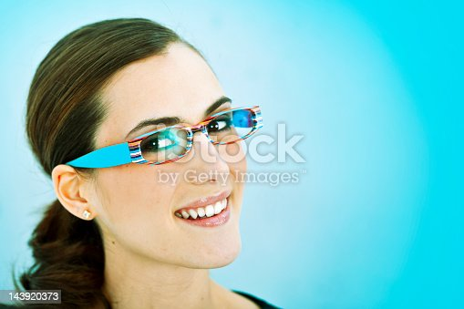 876629044istockphoto Woman wearing colorful glasses 143920373