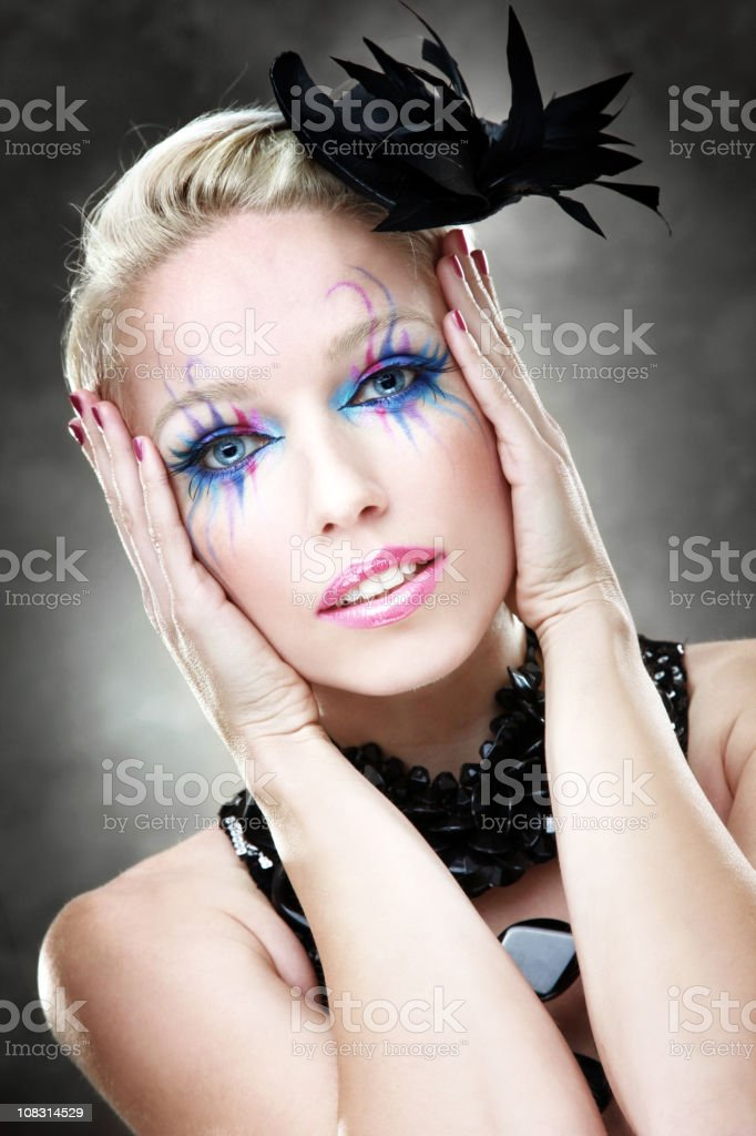 Woman wearing colorful makeup royalty-free stock photo