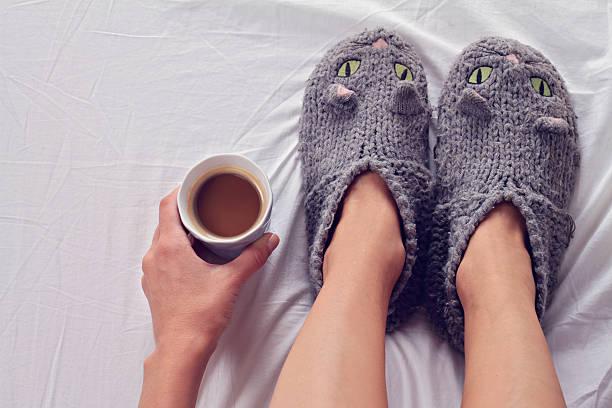 Woman wearing cozy warm wool socks close up. stock photo