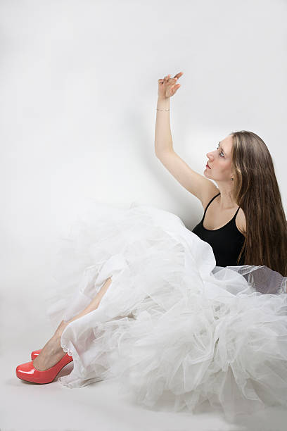woman wearing crinoline and shoes - petticoat stock pictures, royalty-free photos & images