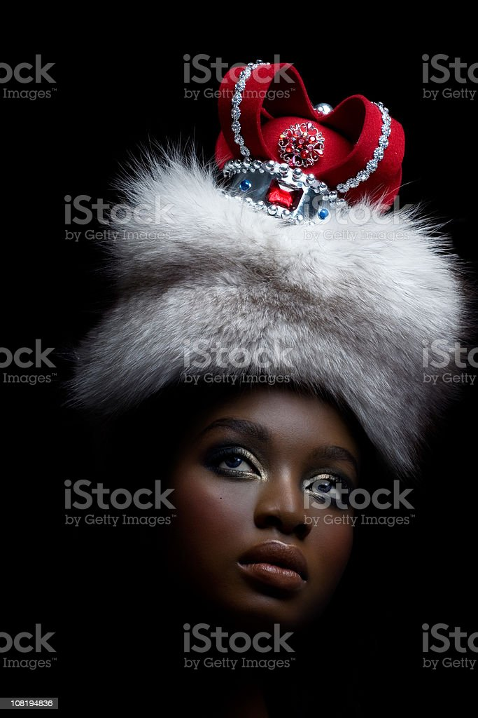 Woman Wearing Crown and Fur stock photo