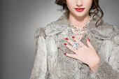 istock Woman wearing diamonds and a fur coat 80486328