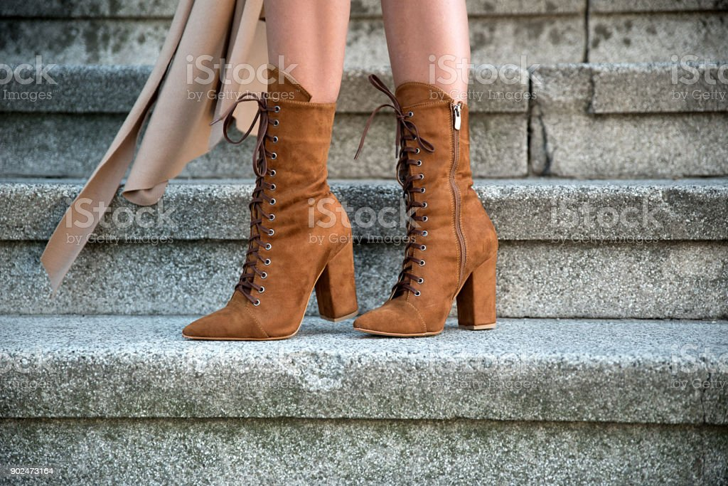 Woman wearing elegant boots stock photo