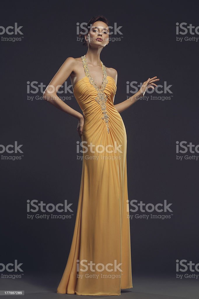 Woman wearing evening dress stock photo