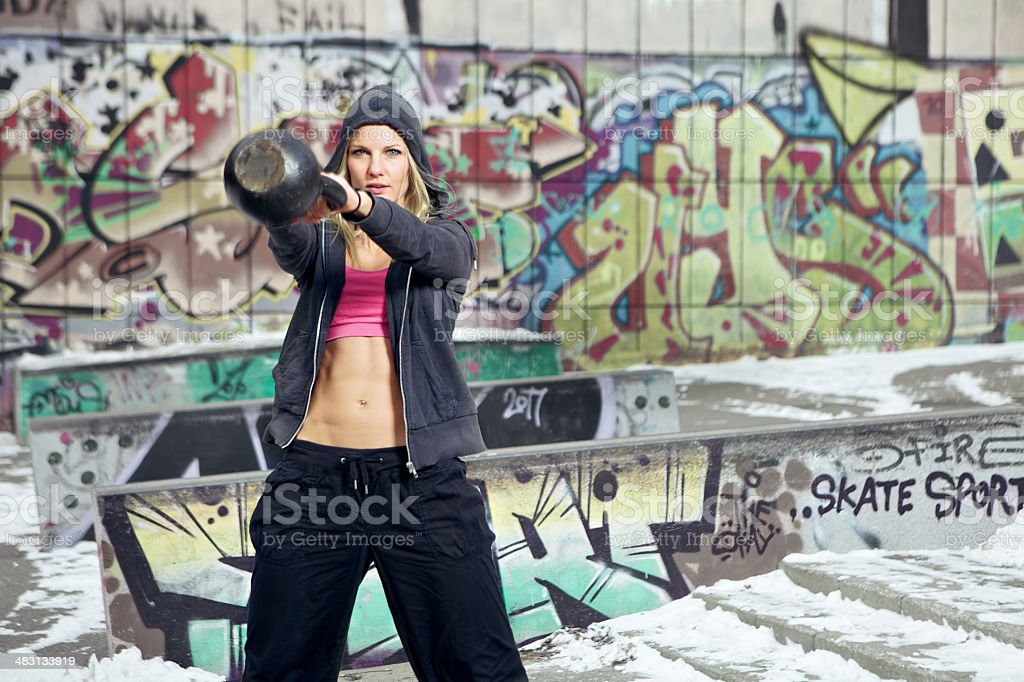 Woman wearing exercise clothes in a ghetto royalty-free stock photo