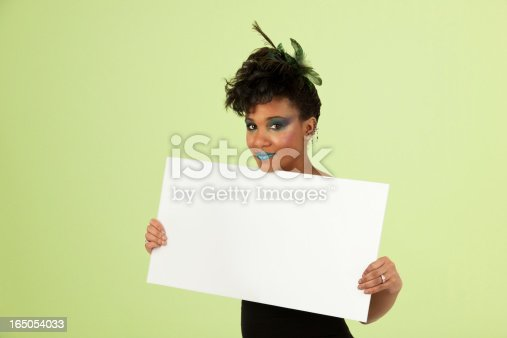 807419930 istock photo Woman Wearing Extreme Makeup Holding Blank Placard 165054033