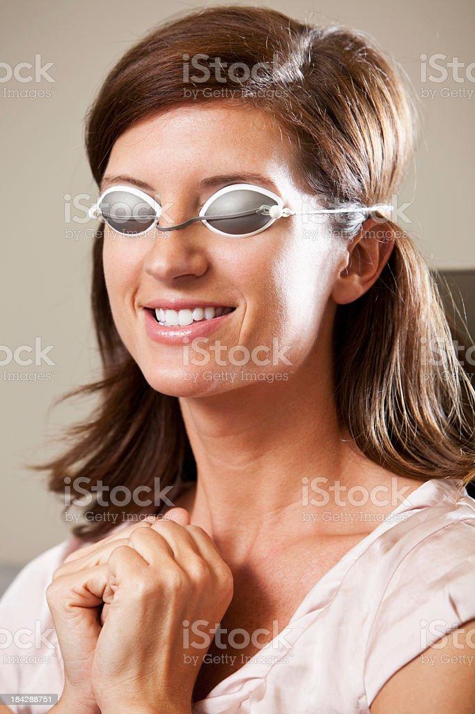 Woman wearing eye mask at beauty spa stock photo