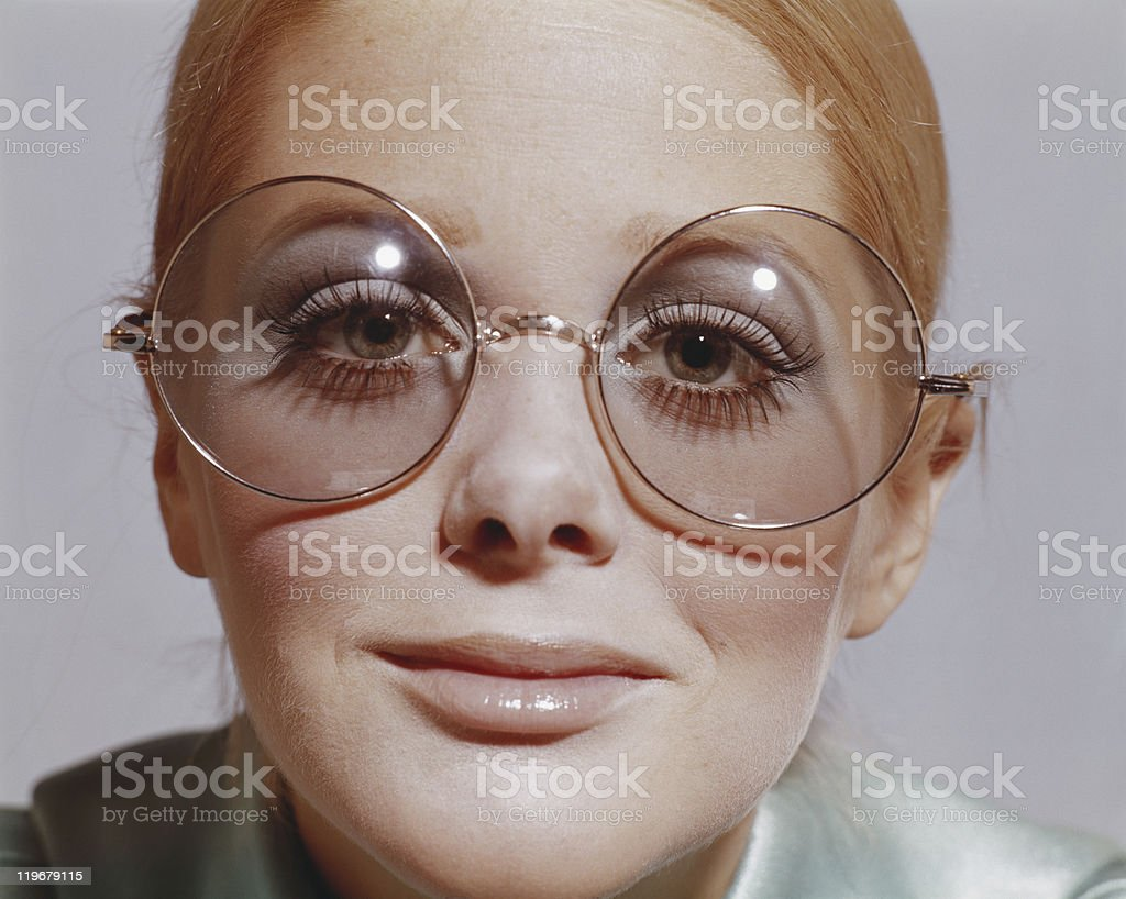 Woman wearing eyeglasses, smiling, portrait stock photo