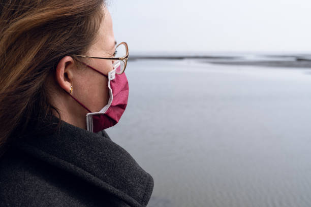 Woman wearing face mask to prevent Corona infection stock photo