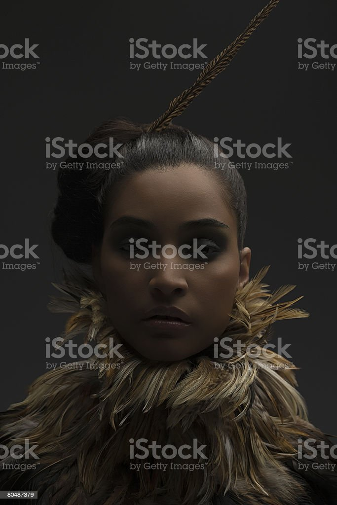 A woman wearing feather accessories 免版稅 stock photo