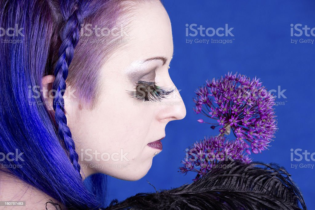 Woman wearing feather eyelashes with flower. royalty-free stock photo