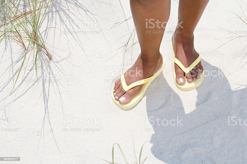 Woman wearing flip flops stock photo