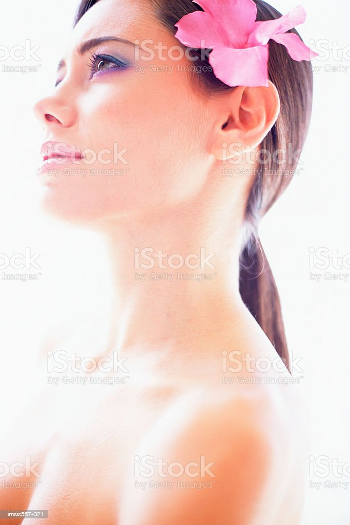 Woman wearing flower in hair royalty-free stock photo