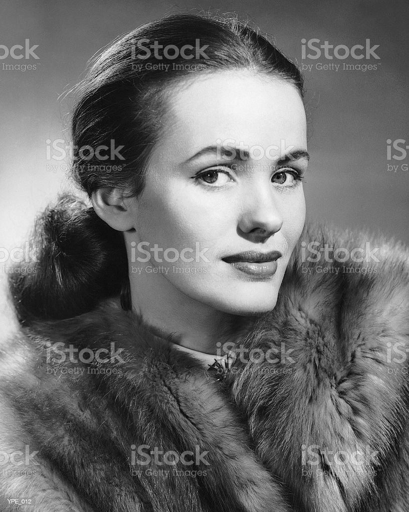 Woman wearing fur coat royalty free stockfoto