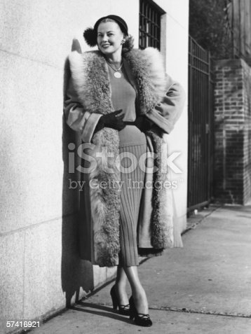 istock Woman wearing fur coat posing outdoors, (B&W), (Portrait) 57416921
